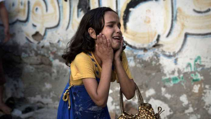 "ATTENTION EDITORS - REUTERS PICTURE HIGHLIGHT TRANSMITTED BY 2230 GMT ON JULY 28, 2014 FOR06 A Palestinian girl reacts at the scene of an explosion that medics said killed eight children and two adults, and wounded 40 others at a public garden in Gaza City. REUTERS/Finbarr O'Reilly REUTERS NEWS PICTURES HAS NOW MADE IT EASIER TO FIND THE BEST PHOTOS FROM THE MOST IMPORTANT STORIES AND TOP STANDALONES EACH DAY. Search for ""TPX"" in the IPTC Supplemental Category field or ""IMAGES OF THE DAY"" in the Caption field and you will find a selection of 80-100 of our daily Top Pictures. REUTERS NEWS PICTURES.  TEMPLATE OUT"