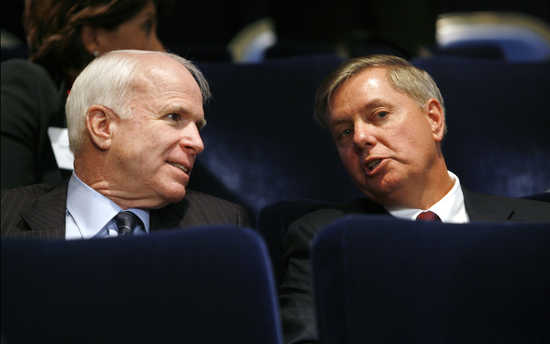 U.S. Republican Senators John McCain (L) and Lindsey Graham talk during the Fiscal Responsibility Summit at the White House in Washington February 23, 2009.       REUTERS/Kevin Lamarque   (UNITED STATES)