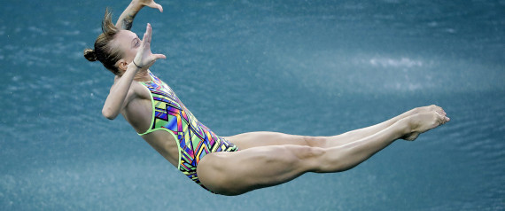 Russia's Nadezhda Bazhina competes during the women's 3-meter springboard diving preliminary round in the Maria Lenk Aquatic Center at the 2016 Summer Olympics in Rio de Janeiro, Brazil, Friday, Aug. 12, 2016. (AP Photo/Wong Maye-E)