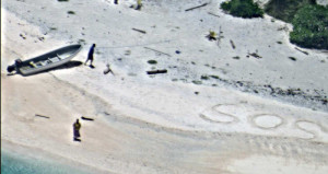 "EAST FAYU ISLAND, Micronesia (Aug. 25, 2016) A pair of stranded mariners signal for help by writing ""SOS"" in the sand as a U.S. Navy P-8A Poseidon aircraft crew from Patrol Squadron (VP) 8 flies over in support of a Coast Guard search and rescue mission. The P-8A crew flew in support of U.S. Coast Guard Sector Guam after AMVER vessel British Mariner reported light signals from an uninhabited island in the state of Chuuk in the Federated States of Micronesia (FSM). Patrol boat Palikir from Federated States Micronesia is currently en route to conduct rescue operations. VP-8, based in Jacksonville, Fla., is in the midst of a routine deployment to the U.S. 7th Fleet area of operations. (U.S. Navy photo/Released)"