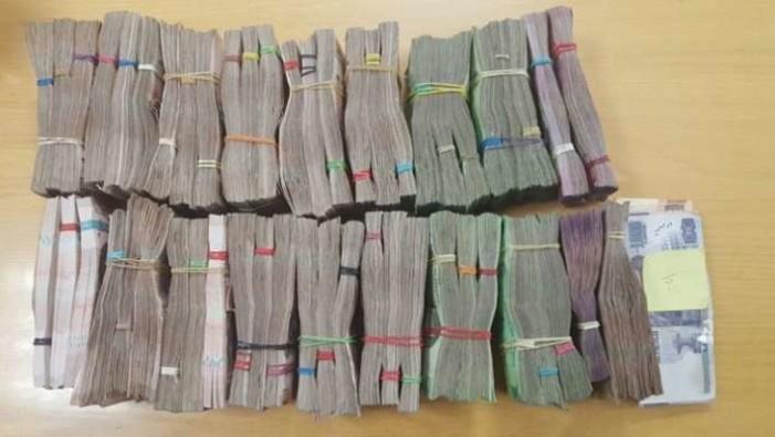 Detienen a peruano con más de $2 millones en el AICM