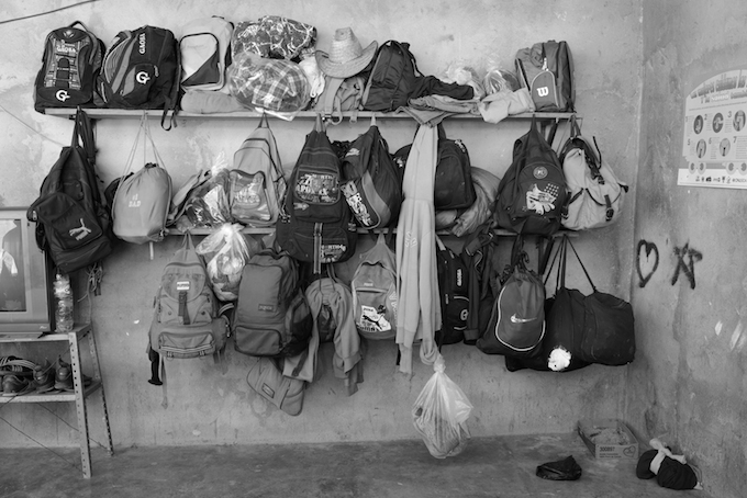 Backpacks hold migrants' possessions at a shelter for migrants in Chahuites, Oaxaca.
