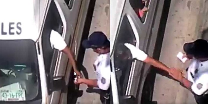 Captan a policía de transito recibiendo 'moches' (VIDEO)