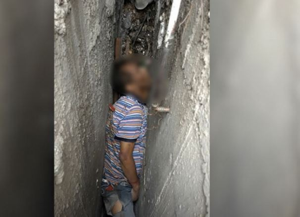 Hallan muerto entre dos paredes a hombre en Iztacalco
